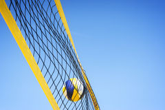 Beachvolley ball caught in net Royalty Free Stock Photography