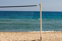 Beachvolleyball net in front of the ocean Royalty Free Stock Images
