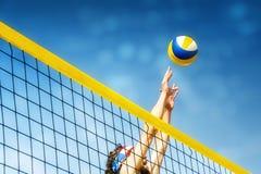 Beachvolleyball player net. Beachvolley ball player jumps on the net and tries to blocks the ball stock photos