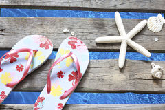 Beachwear on the pier at sea holiday vacation background Royalty Free Stock Images