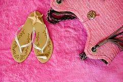 Beachwear on pink towel stock image