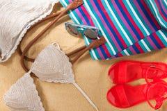 Beachwear in the sand stock photos