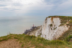 Beachy Head cliff down to the lighthouse when the tide is out. stock photos