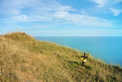 Beachy Head cliff, the highest at Seven Sister country park and graves of suicides who jumped down and blue seascape of English ch stock photo