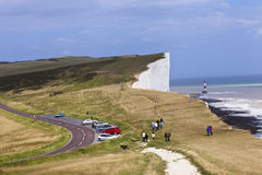 Beachy Head Eastbourne. A view from top of Beachy Head looking at the cliffs and lighthouse in Eastbourne, England Stock Image