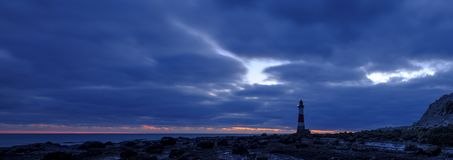Beachy Head Lighthouse at sunset into the blue hour - stitched panorama processed with HDR - East Sussex, UK stock photos