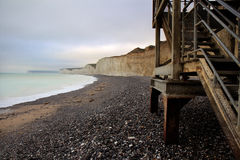Beachy Head. A photo taken from the beach at the stunning famous Beachy Head featuring the metal steps leading down Stock Images