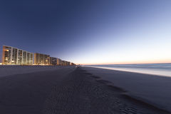 The Beack. Condos line one side of the beach, going as far as the eye can see Stock Images