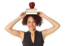 Beack to school. Education concept with books, apple and a big smile Royalty Free Stock Photography