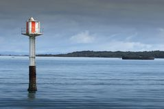 Beacon. A beacon stands guard on the Rangitoto Channel in the Hauraki Gulf, New Zealand Stock Photos