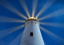 Beacon. With light rays and stars Royalty Free Stock Images