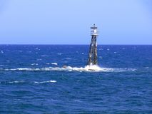 Beacon Breaking the Waves Stock Images