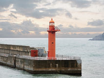 Beacon on a breakwater Royalty Free Stock Images