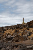 Beacon Capelinhos on the shore island Faial, Azores Royalty Free Stock Photography