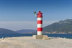 Beacon on the coast of Bay of Kotor. Montenegro Stock Photo
