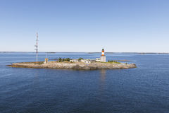 Beacon and communication tower on an island. In Finland Stock Photo