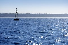 Beacon floating on blue ocean as guide help Stock Images