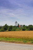 Lighthouse and field Stock Photography