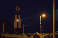 Beacon glowing at night. Coastal structures. Russia Royalty Free Stock Photos