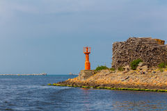 Beacon at the harbor channel Royalty Free Stock Photo