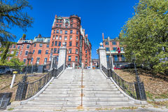 Beacon Hill Boston Massachusetts. Boston, Massachusetts, USA - September 12, 2016: Stairway leads up to the historical Federal Architectural style buildings on Royalty Free Stock Image