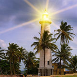 Beacon light against and evening sky Royalty Free Stock Images