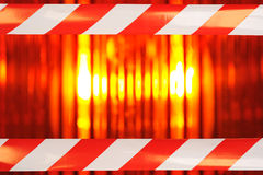 Beacon light with barrier tape Stock Photography