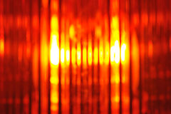 Beacon light. Building lot background with macro detail of an orange beacon light Royalty Free Stock Image