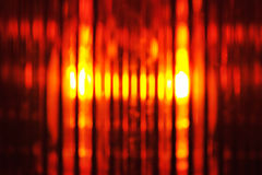 Beacon light. Building lot background with macro detail of an orange beacon light Stock Photos