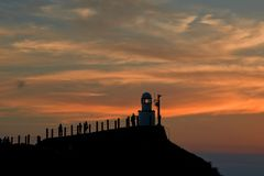 The beacon of light on the hill with sunset  in Lanyu Orchid Island , Taiwan. The beacon of light on the hill with sunset  in Orchid Island, Taiwan Stock Photo