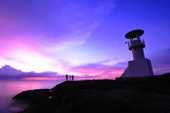 Beacon. Lighthouse searchlight beam through marine air at night royalty free stock image
