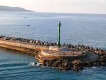 Beacon in Livorno harbour Royalty Free Stock Photo