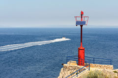 Beacon And Motorboat Royalty Free Stock Images