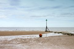 Beacon with offshore windfarm on seaside in Wales UK Stock Images