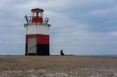 Beacon on the pier Stock Photo