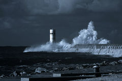 Beacon and pier under heavy storm Royalty Free Stock Photos