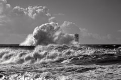 Beacon and pier under heavy storm Royalty Free Stock Image