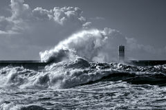Beacon and pier under heavy storm Stock Photography