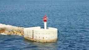 Beacon in the port of Genoa Stock Photo