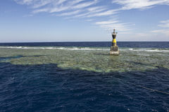 Beacon on a reef. In the Red Sea Royalty Free Stock Images