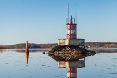 Beacon on the rocks and buoy of Saimaa Canal Royalty Free Stock Photography