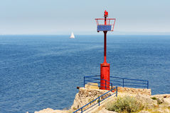 Beacon And Sailboat Stock Photography