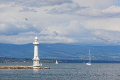 Beacon and the sailing yacht Royalty Free Stock Photography