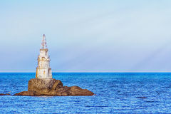 Beacon in the Sea Royalty Free Stock Photo