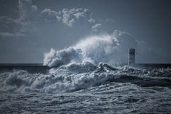 Beacon and pier under heavy storm Stock Image