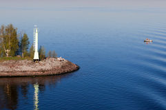 The beacon standing on the coast of the island Stock Photos