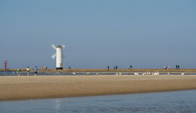 Beacon in Swinoujscie. Stawa Mlyny – the navigation beacon built in the form of a windmill on the 19 th century breakwater Royalty Free Stock Image