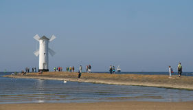 Beacon in Swinoujscie. Stawa Mlyny – the navigation beacon built in the form of a windmill on the 19 th century breakwater Royalty Free Stock Photo
