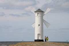 Beacon in Swinoujscie. Stawa Mlyny – the navigation beacon built in the form of a windmill on the 19 th century breakwater. Swionoujscie, Poland Stock Photography