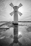 Beacon windmill Stawa Mlyny, town landmark against the sun. Royalty Free Stock Images